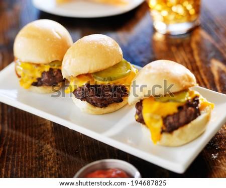 three mini burger sliders in a row
