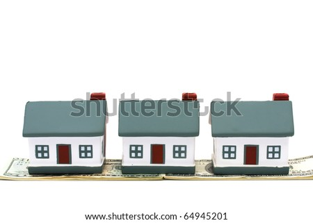 Three model homes isolated on a white background with money, house money