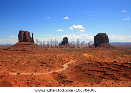 Three monuments in Monument Valley and the road - stock photo