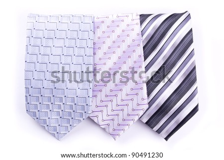 Three multi-colored tie isolated on white