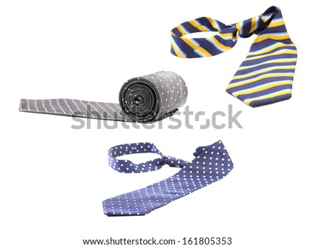 Three multi-colored tie on a white background