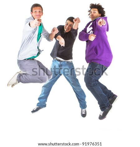 Three multiracial teenagers jumping over joy over white background.