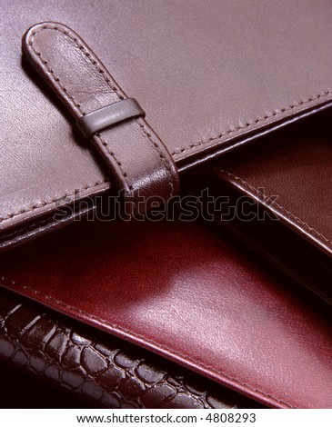 three natural leather wallets forming a stair
