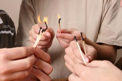 Three naughty boys playing with fire in the house