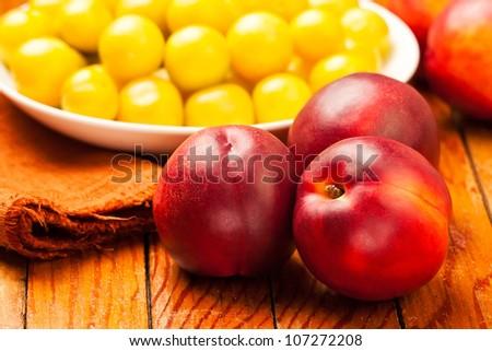 three nectarines still life on wooden table