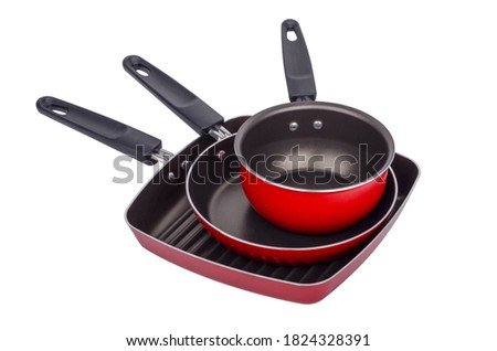 Three new red and black frying pan set isolated on white background Foto stock ©