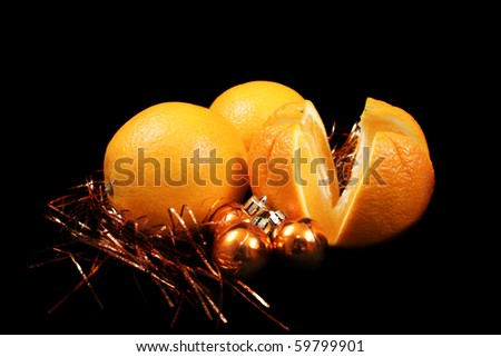 Three new year oranges over gold Christmas balls