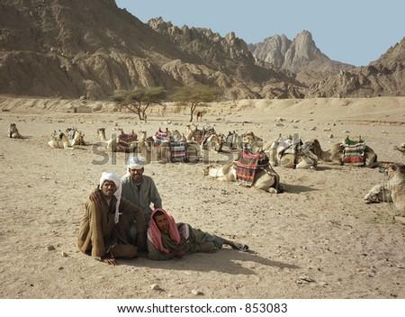 Three nomads in Egyptian desert