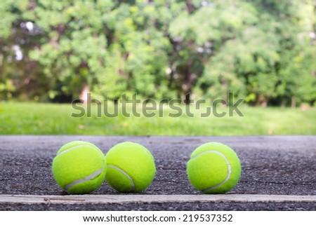 Three of Tennis ball on the ground