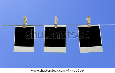 Three old photos on string isolated on white background