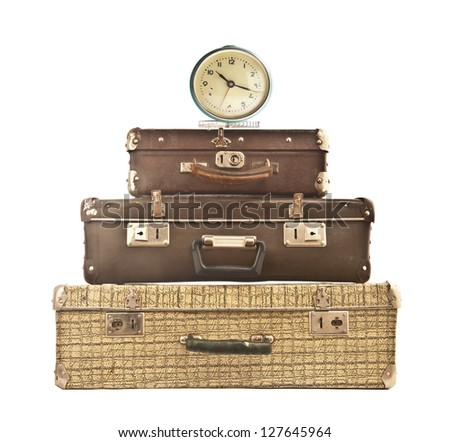 three Old suitcase with Alarm Clock