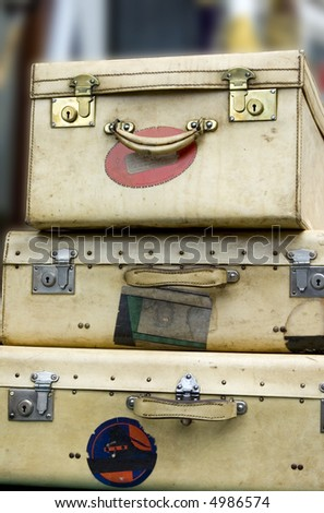 Three old suitcases stacked high