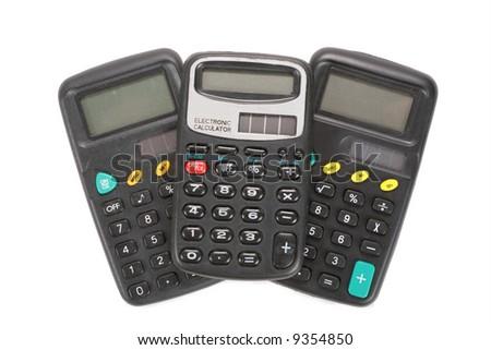 Three old vintage calculators - stock photo