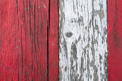 Three old wooden boards with cracked paint. Weathered white and red boards. Cracked wood texture. Abstract background.
