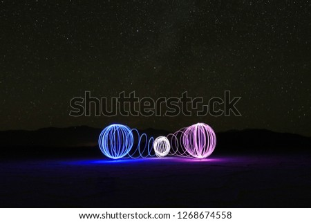 Three Orbs in the Death Valley Salt Flats With the Milky Way Stars #1268674558