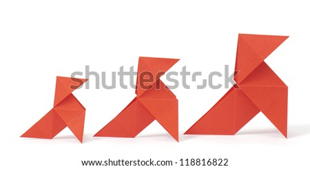 Three origami birds on white background. Concept of growth.