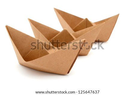 three origami boats on sailing concept, cardboard recycle paper