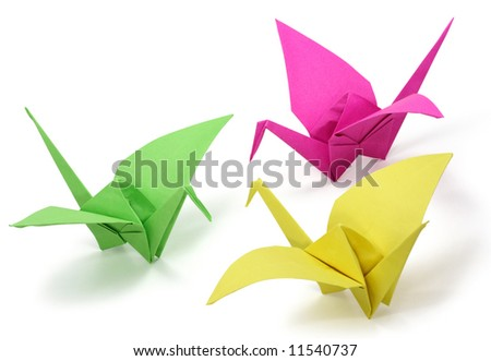 Three origami cranes on white background