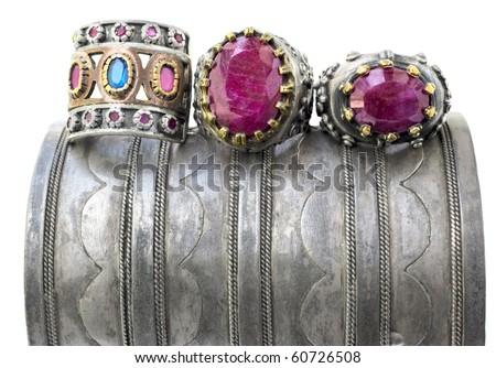 three ottoman style vintage rings on a grunge silver bracelet.