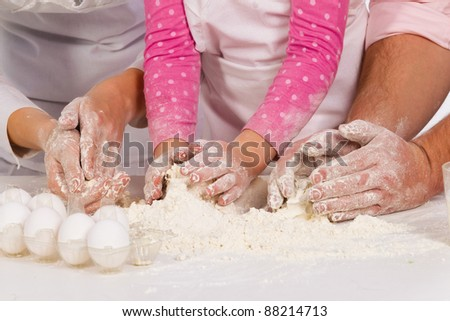 Three pair of Hands kneading  dough