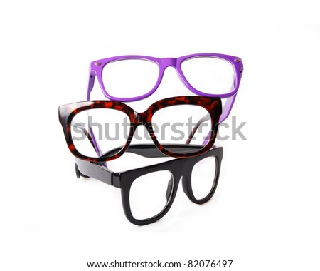Three pairs colorful eyeglasses isolated on white background