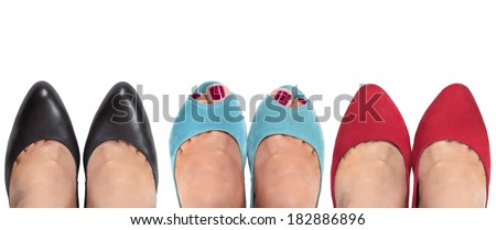 Three pairs of female legs on a white background. View from the top.
