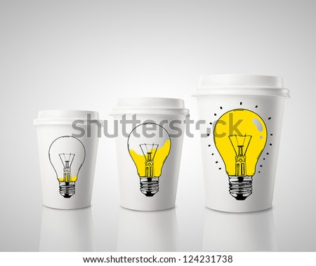 three paper cup of coffee and drawing lamp