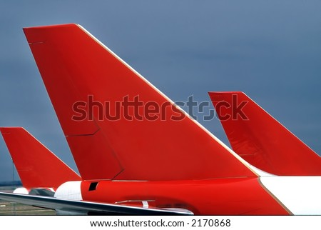 Three passenger aircraft tails, forming interesting pattern