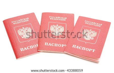 three passports of Russian Federation's citizen isolated on white