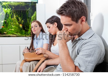 Three patients sitting in doctor's waiting room
