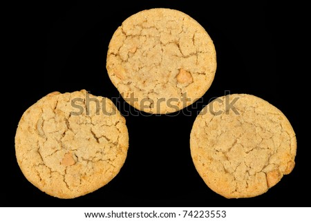 Three Peanut Butter Cookies on a Black Background