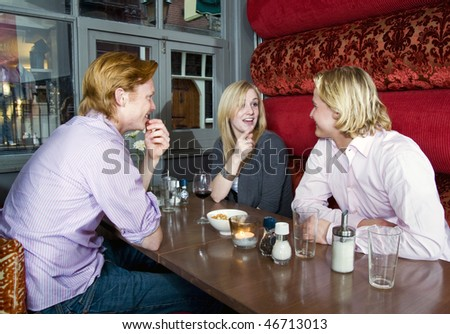 Three people chatting in a cafe