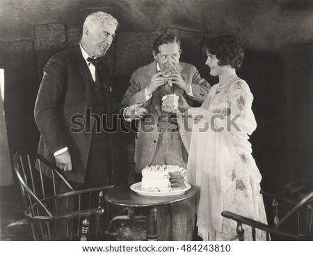 three people enjoying a slice...