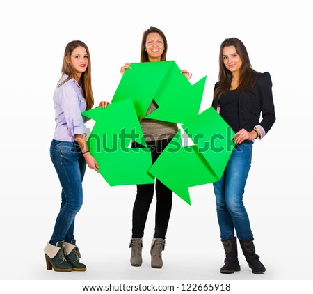 Three people holding a recycle sign