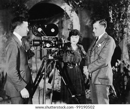 three people with movie camera