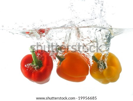 three peppers falling in water