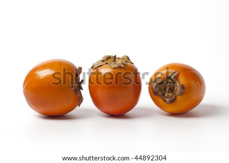 Three Persimmon, sharon, khaki, on white background