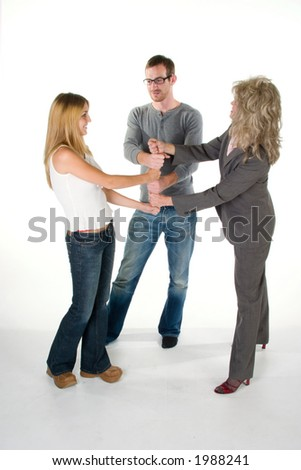 Three person business team with fists interlocked in a stack.