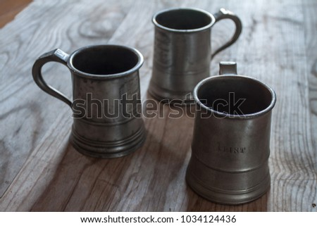 three pewter tankards #1034124436