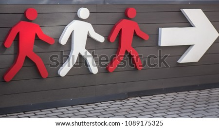 Three pictograms of  person walking in direction of white arrow. #1089175325