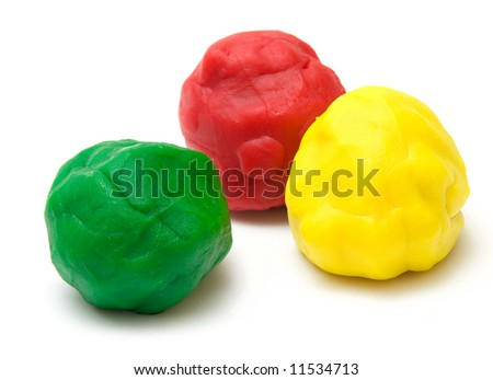 three pieces of color plasticine on white background - stock photo