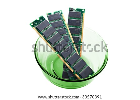 Three pieces of computer RAM memory in green bowl