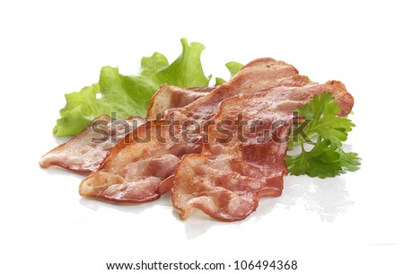 Three pieces of fried bacon with parsley and lettuce on the white
