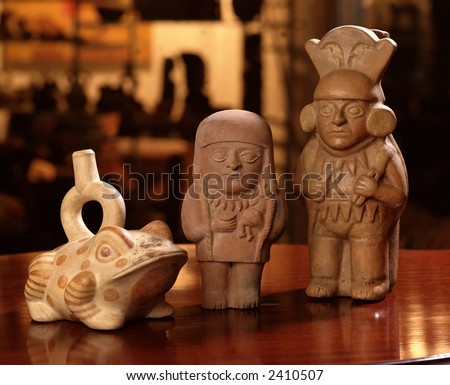 three pieces of pre columbian peruvian pottery over a table