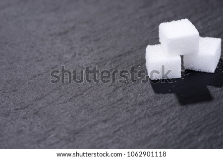 Three pieces of sugar cubes isolated on black background #1062901118