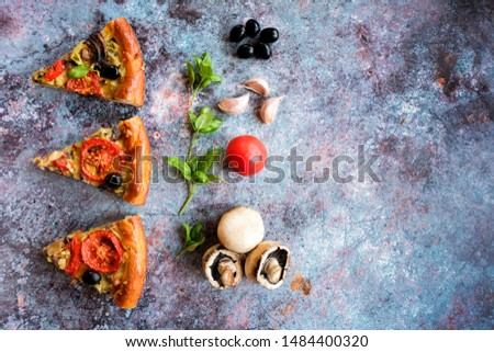 Three pieces of vegetarian homemade pizza lie on a blue background. Pizza with mushrooms, tomatoes, olives, Basil and garlic on a blue background. Top view. Copy space. #1484400320