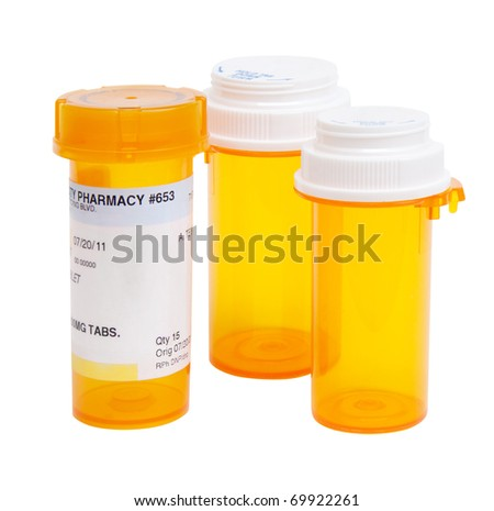 Three pill bottles isolated