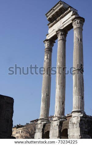 Three pillars of the Temple of the Dioscuri. The Temple of Castor and Pollux introduced the Greek cult of the dioscuri into Rome. It is located in the Roman Forum.