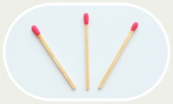 Three pink matches isolated on white background. Top view.
