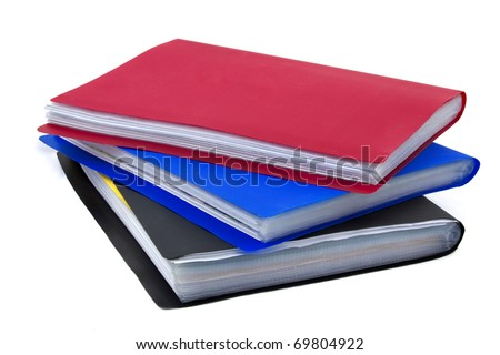 Three plastic 1-inch binders, red, blue and black, with clear plastic protector sheets and papers filed within them.